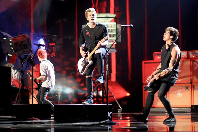 Recording artists 5 Seconds of Summer perform onstage at the 2014 American Music Awards at Nokia Theatre L.A. Live on November 23, 2014 in Los Angeles, California. (Photo by Christopher Polk/AMA2014/Getty Images for DCP)