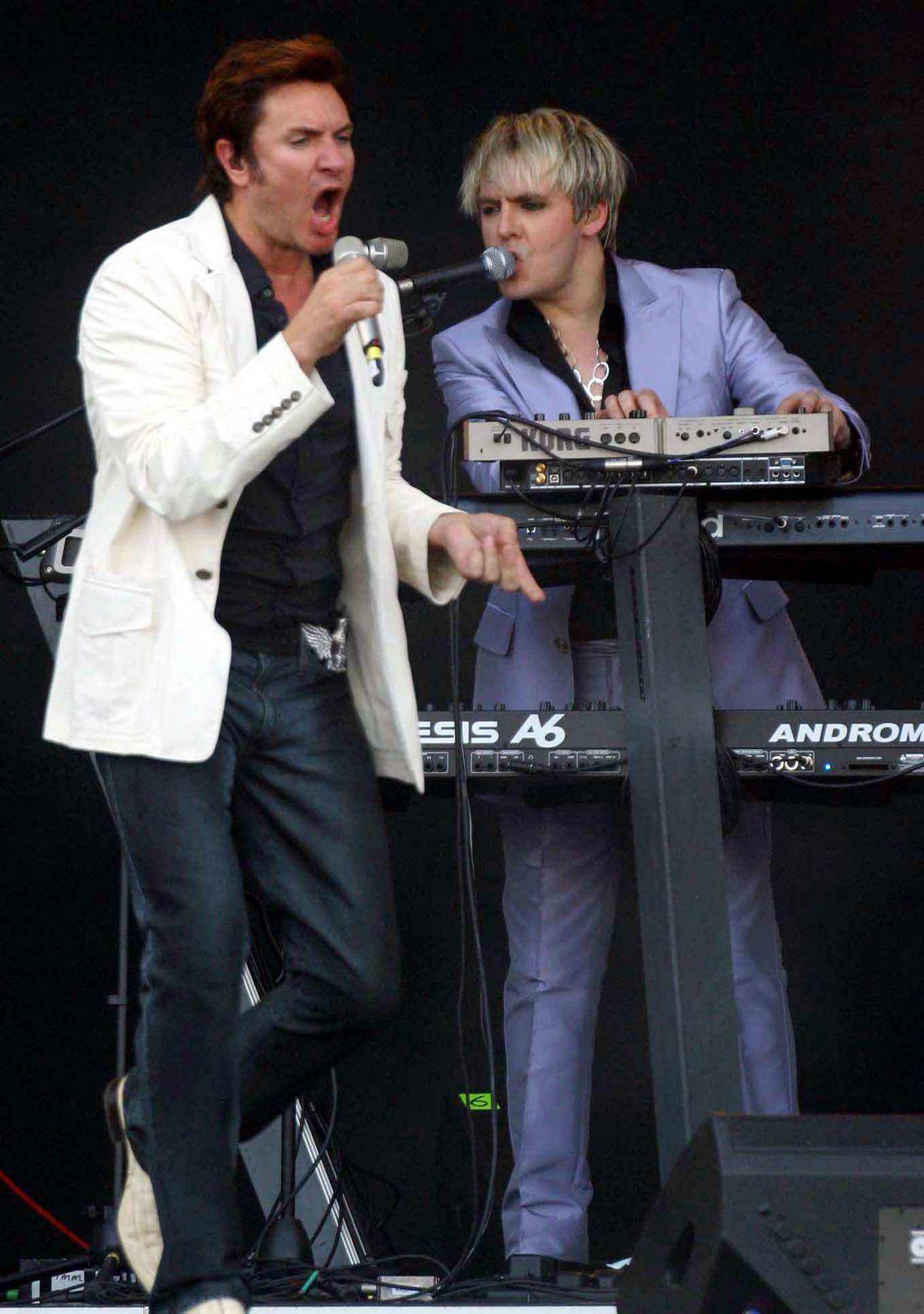 Simon Le Bon, left, and Nick Rhodes of the Duran Duran perform on the stage of Live 8 concert in Rome's Circus Maximus, Saturday, July 2, 2005. Thousands gathered in Rome's ancient Circus Maximus Saturday to watch Faith Hill, Duran Duran and a long list of Italian stars, in one of 10 concerts across the globe to help raise awareness about African poverty.(AP Photo/Alessandra Tarantino)