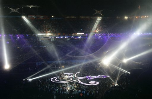 Searchlights and fireworks illuminate Dolphin Stadium as Prince takes the stage in the halftime performance of the Super Bowl XLI football game in Miami on Sunday, Feb. 4, 2007. (AP Photo/Wilfredo Lee)