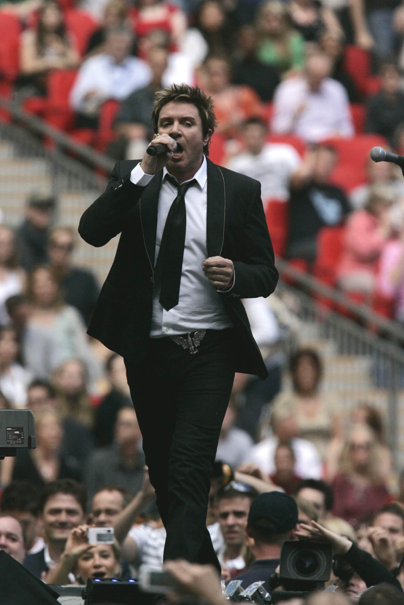 Simon Le Bon of British pop group Duran Duran performs on stage during the Concert for Diana at Wembley Stadium in London, Sunday July 1, 2007. The concert was held on Sunday to mark what would have been the 46th birthday of Diana Princess of Wales. (AP Photo/Matt Dunham)