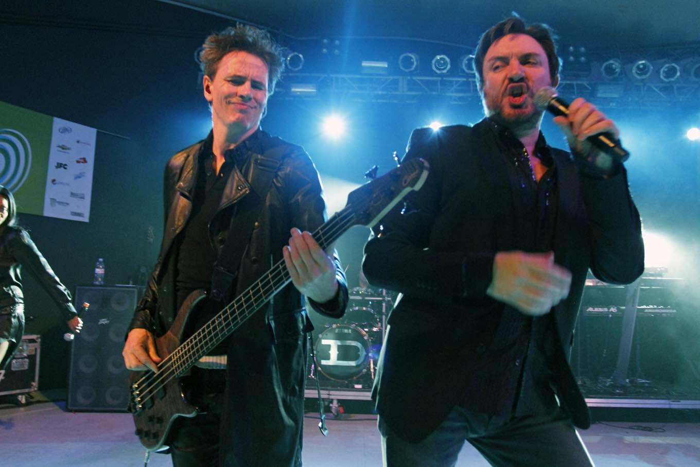 Simon LeBon, right, and John Taylor, of Duran Duran, perform at the SXSW Music Festival in Austin, Texas early Thursday, March 17, 2011. (AP Photo/Jack Plunkett)