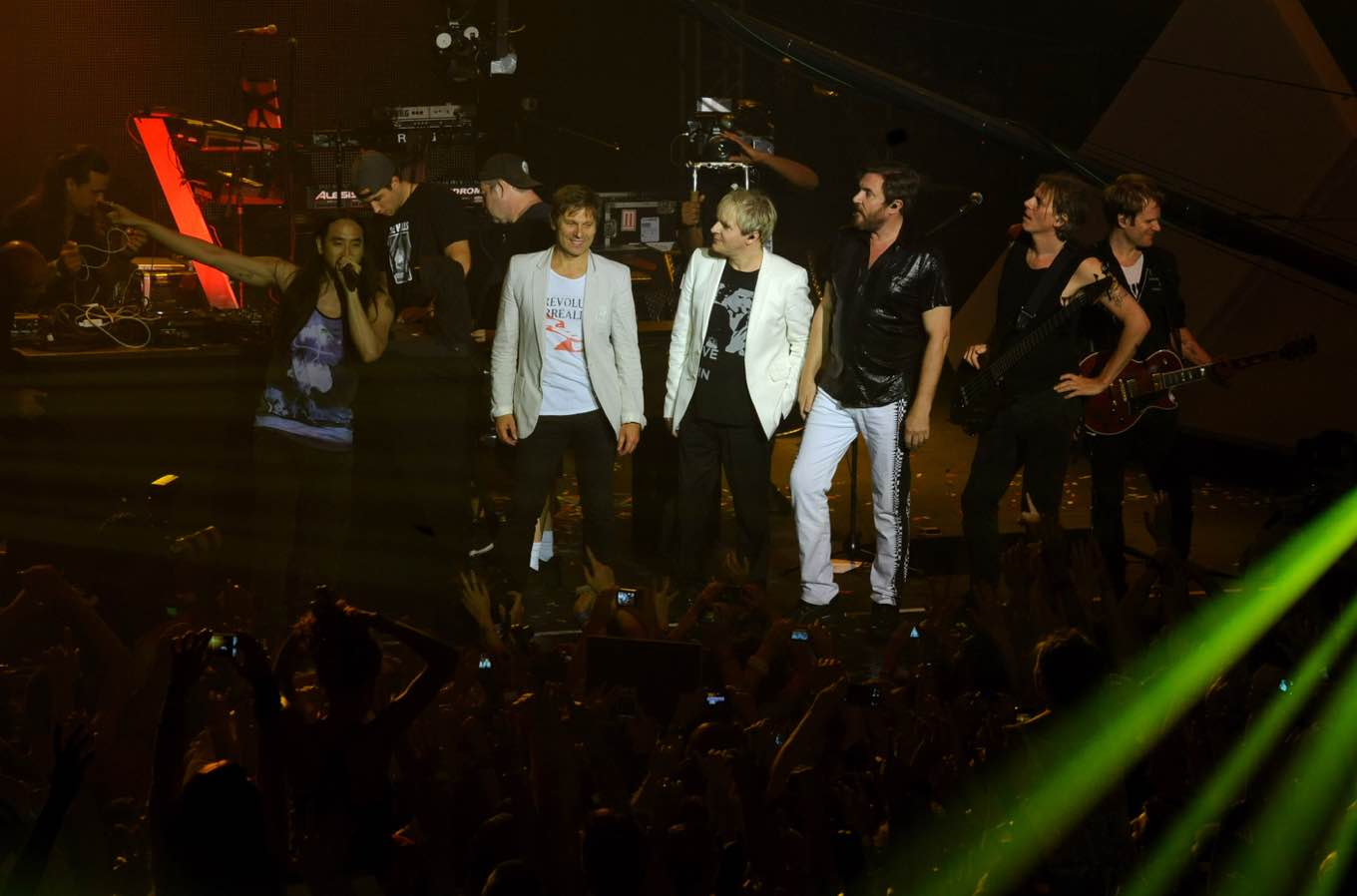 """Duran Duran and DJ Steve Aoki join forces for the first time to debut their remix """"Hungry Like The Wolf - NY Werewolf Mix"""" at Trident's """"See What Unfolds Live"""" event in New York, Wednesday, June 20, 2012. (Photo by Diane Bondareff/Invision for Trident)"""