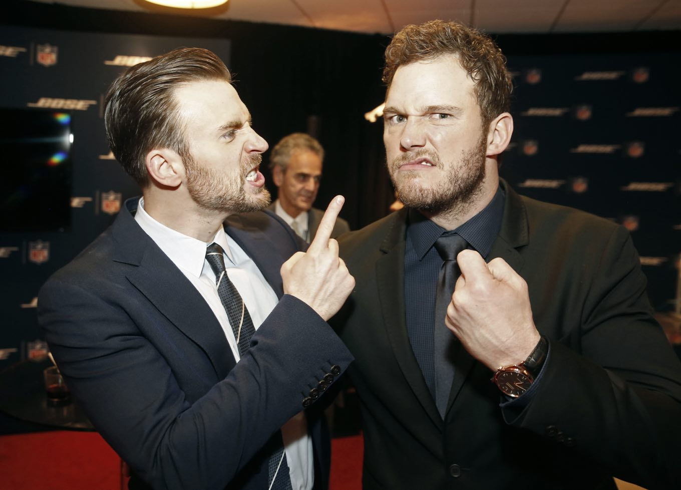 Chris Evans, left, and Chris Pratt who both play super heroes on film waged a friendly bet for a really sweet cause. Here they are at odds backstage at the 4th annual NFL Honors at the Phoenix Convention Center Symphony Hall on Saturday, Jan. 1, 2015. (Photo by: Colin Young-Wolff/Invision for NFL/AP Images)