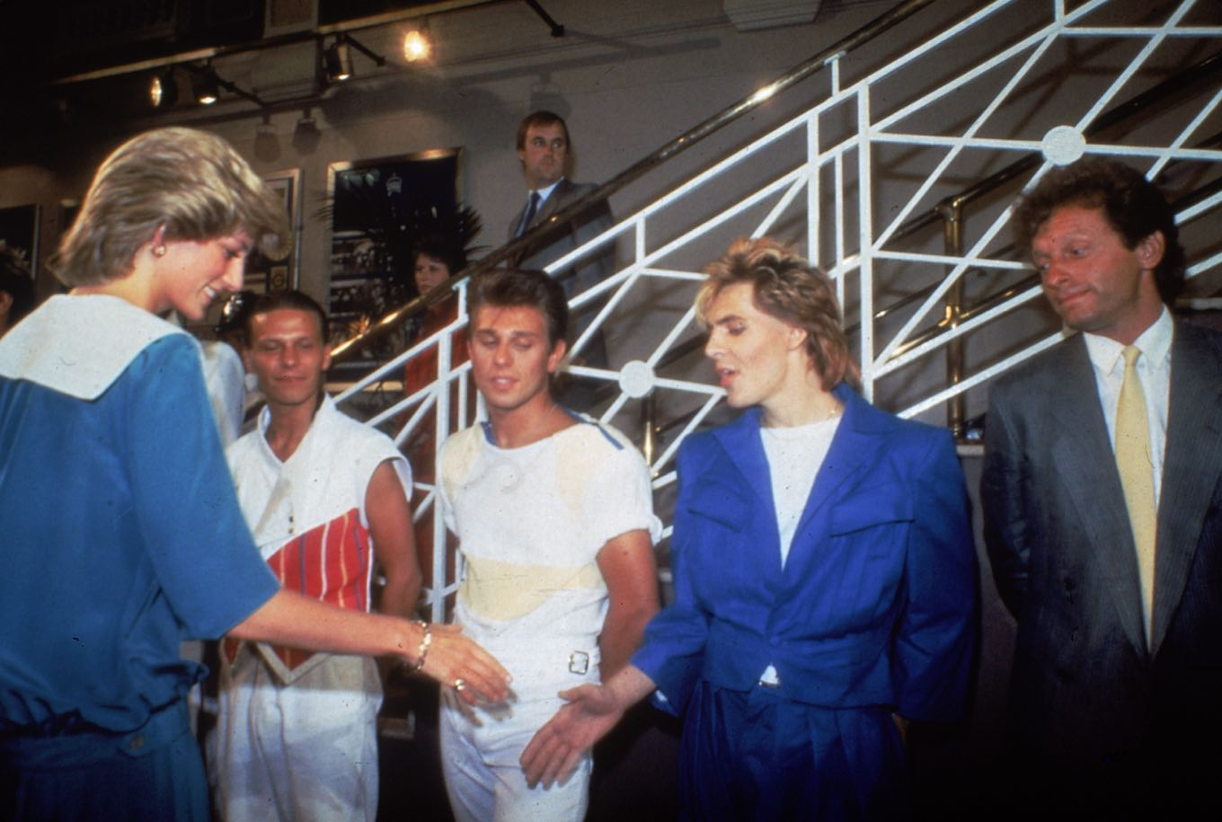 Britain's Princess Diana shakes hands with Nick Rhodes, the keyboard player in her favorite band, British pop group Duran Duran, at a music gala concert in aid of the Prince of Wales Trust Fund in London, England, July 20, 1983. (AP Photo/Bob Dear)