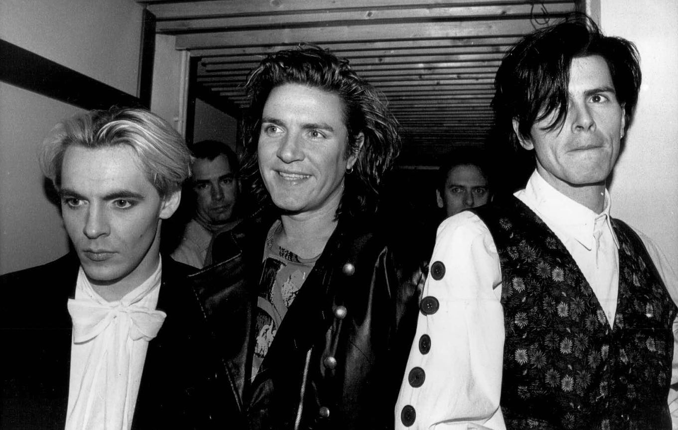 Members of the pop group Duran Duran, who took Milan by storm last night, are shown Dec. 11, 1988, as 1,000 screaming fans greeted them before they played. From left to right: Nick Rhodes, Simon Le Bon and John Taylor. (AP Photo/Press Association/Rebecca Naden)