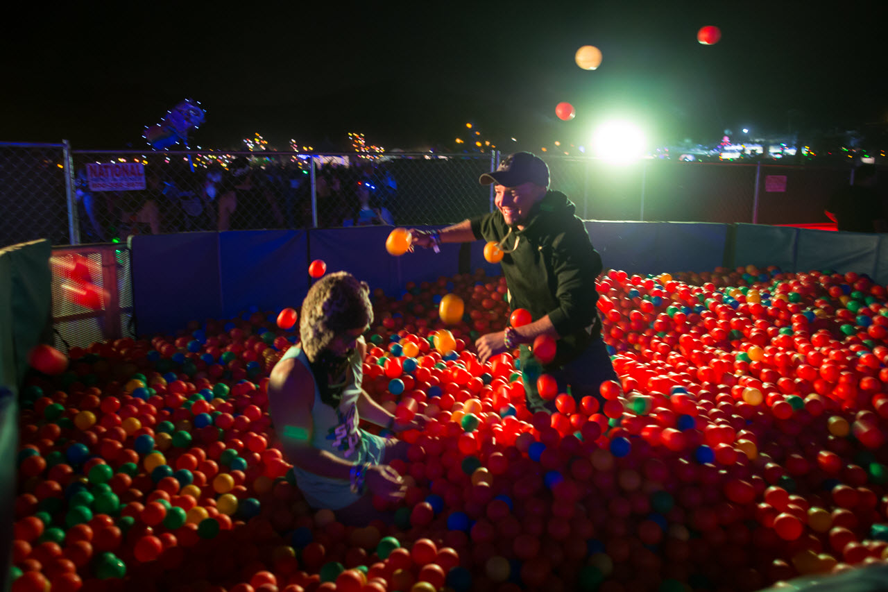 Beyond Wonderland 2015 Festivalgoers playing in the VIP ball pit while watching the live EDM show