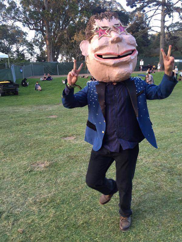 A fan dresses up as Sir Elton John at Outside Lands 2015