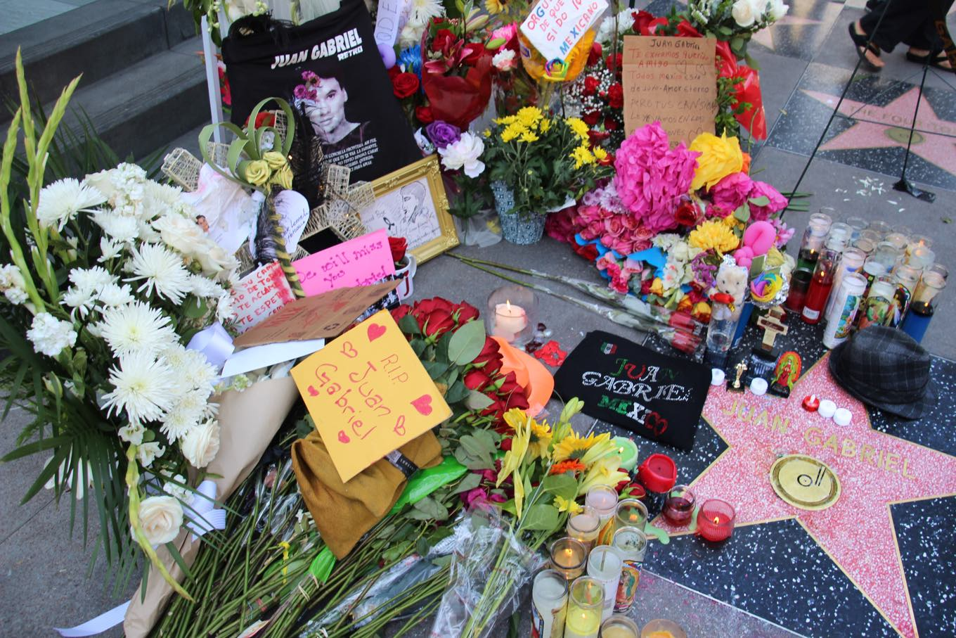 People gather, sing and leave remembrances for Latin sensation Juan Gabriel on Hollywood Blvd on August 29, 2016. (Photo by Ticketmaster)