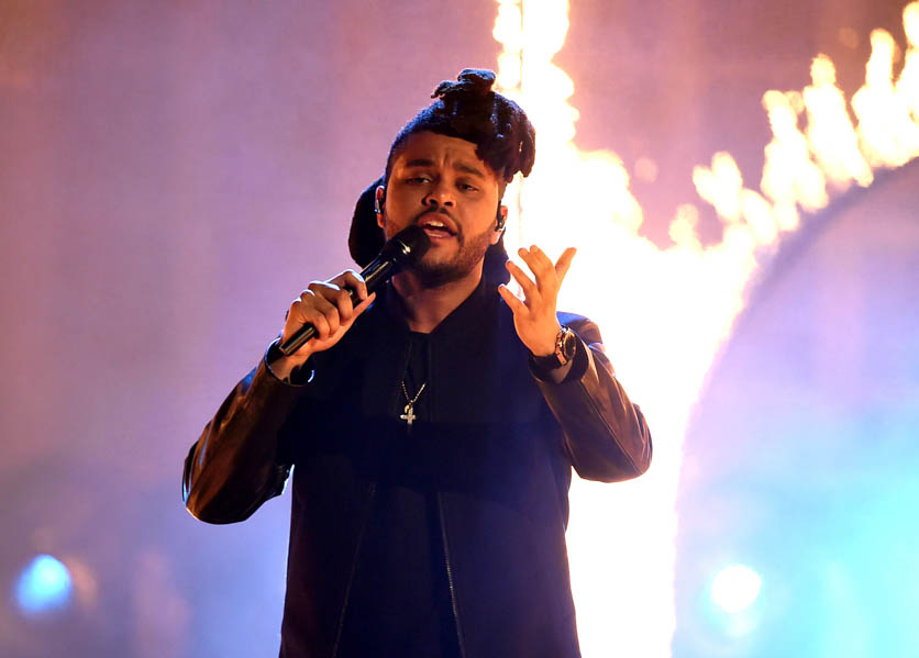 The Weeknd performs onstage during the 2015 American Music Awards at Microsoft Theater on November 22, 2015 in Los Angeles, California. (Photo by: Kevin Winter/Getty Images)